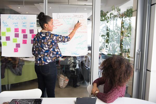 Woman explaining customer journey to employee