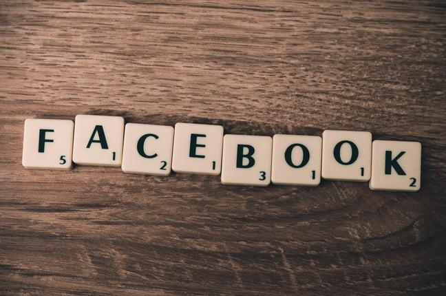 Scrabble tiles spelling out Facebook