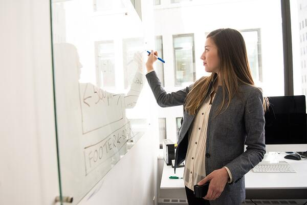 Woman drafting a website on a whiteboard