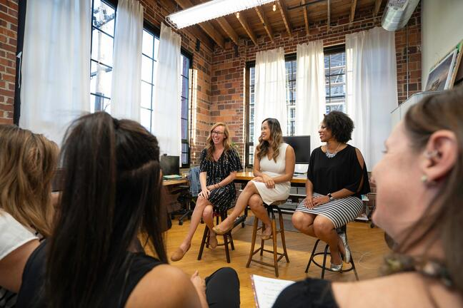 Women at a small speaking event