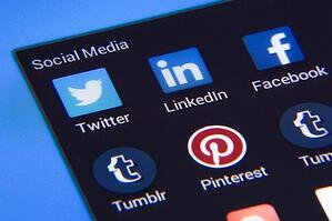 View of social media on a screen, includes Twitter, LinkedIn, Facebook, Tumblr and Pinterest icons
